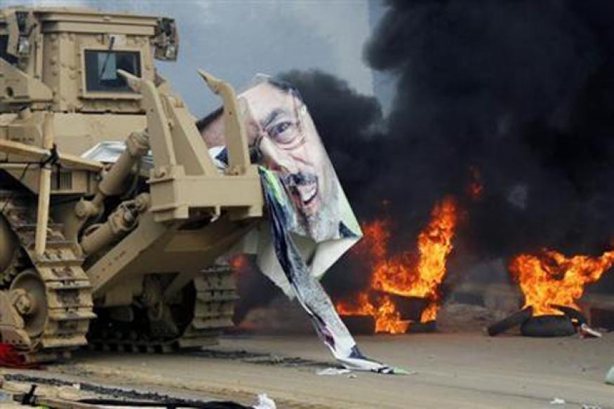Egypt seethes under curfew as security forces kill hundreds of Morsi supporters