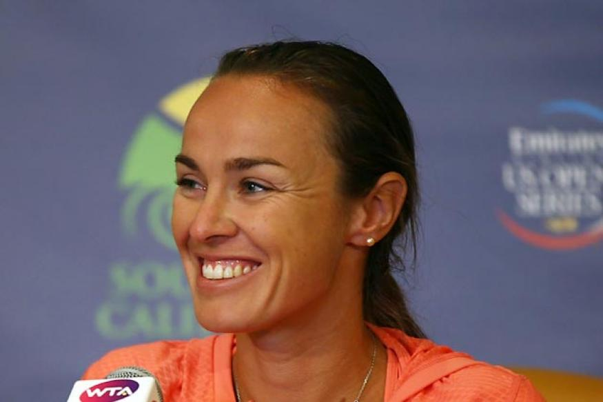 Hingis rules out playing singles despite doubles return