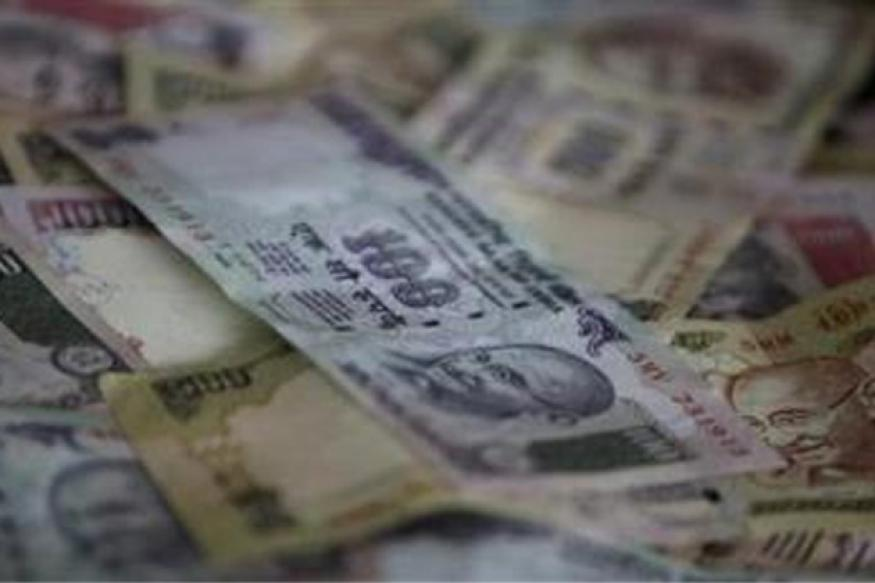 Rupee opens at 64.30 per dollar, gains 25 paise