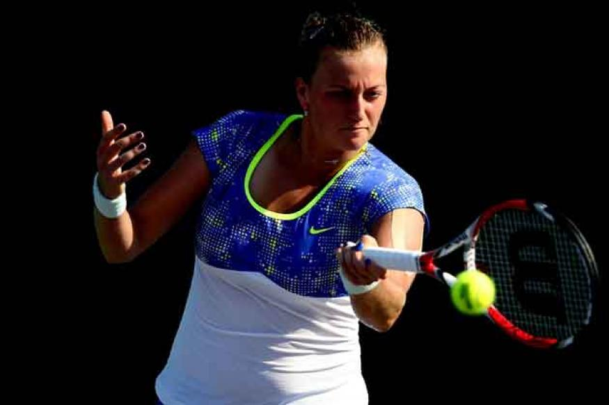 Kvitova advances, Kerber upset at New Haven Open