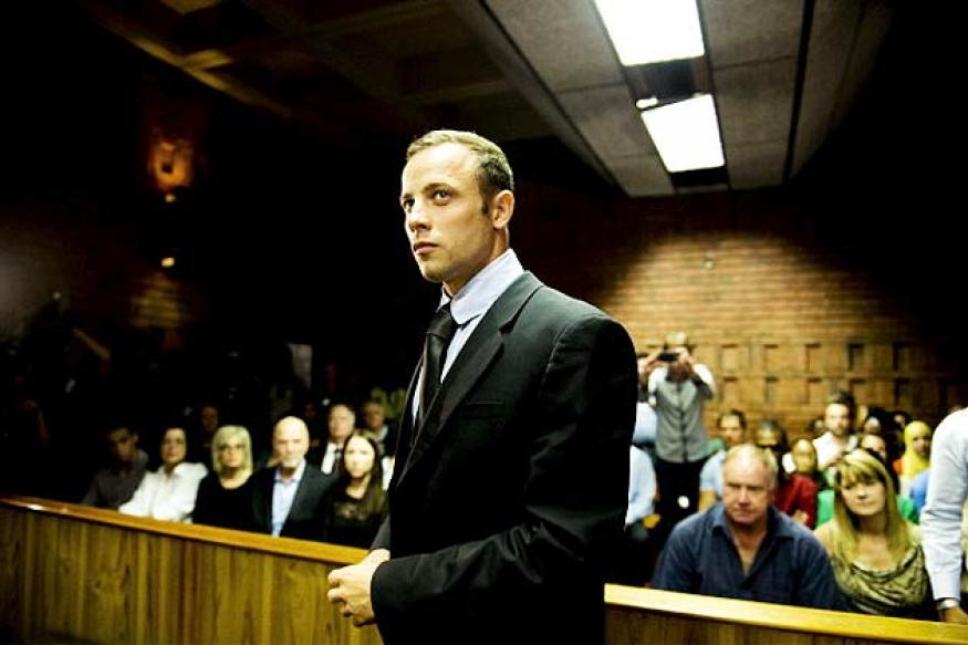 Pistorius weeps in court, murder trial set for March 2014
