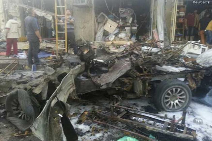Series of car bombs target Iraqi shoppers, killing more than 50