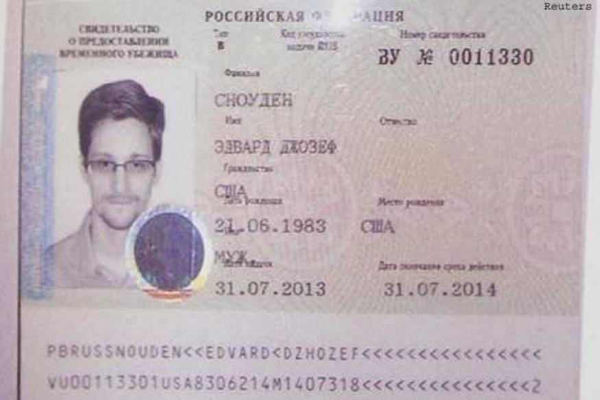 Snowden downloaded NSA secrets while working for Dell, say sources