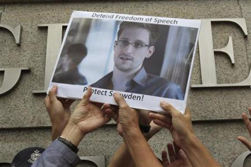 Snowden downloaded NSA secrets while working for Dell: Sources