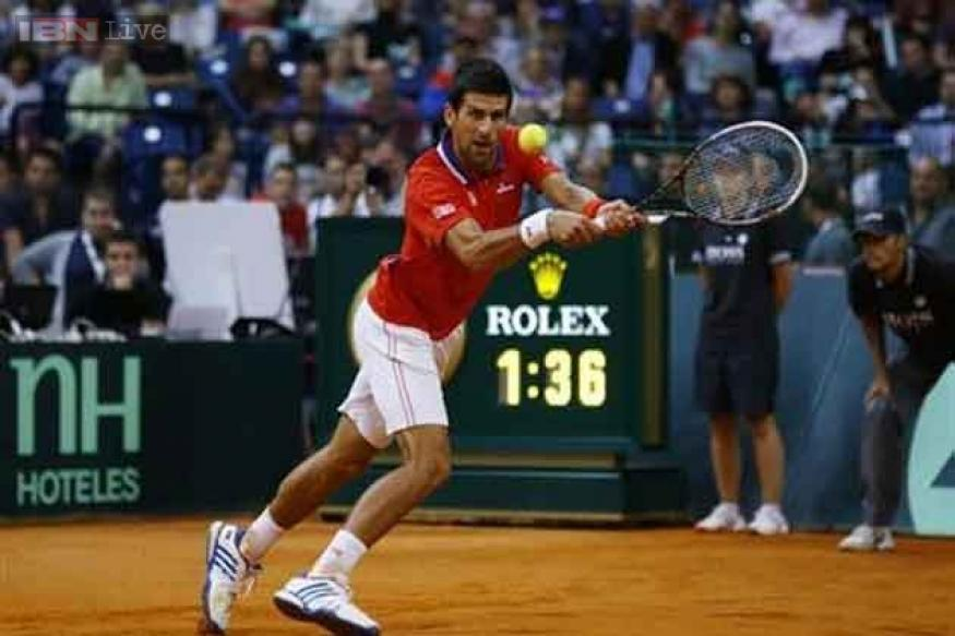 Djokovic puts Serbia ahead before Canada hit back