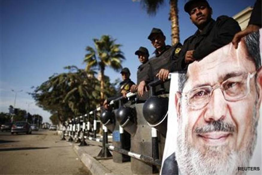 Mohamed Morsi faces trial as US reviews aid to Egypt