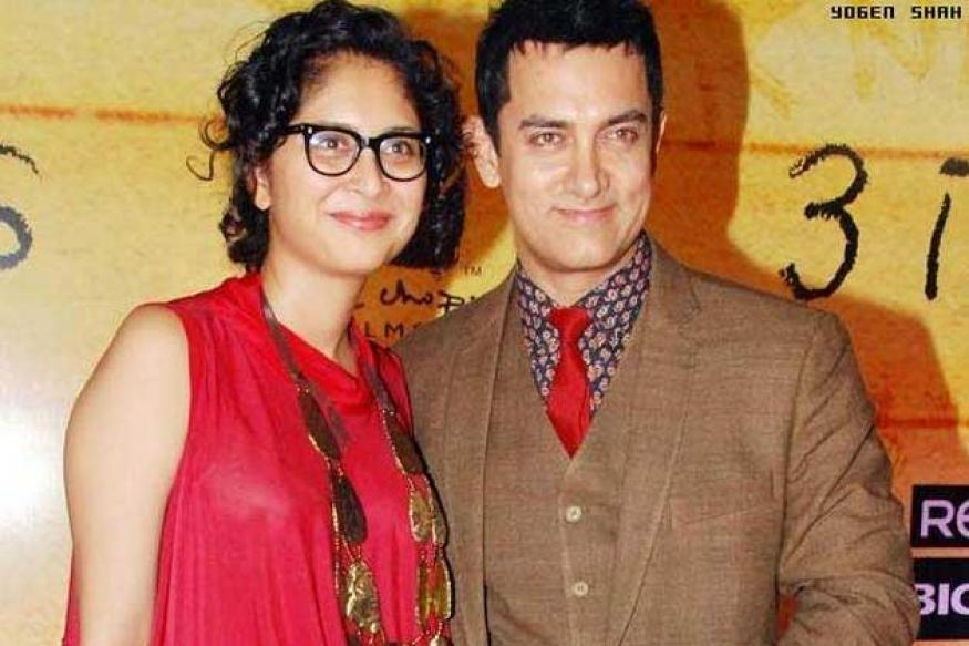 What are Aamir Khan and Karan Johar doing in Assam?