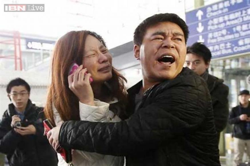 Malaysian plane still missing; questions over false IDs