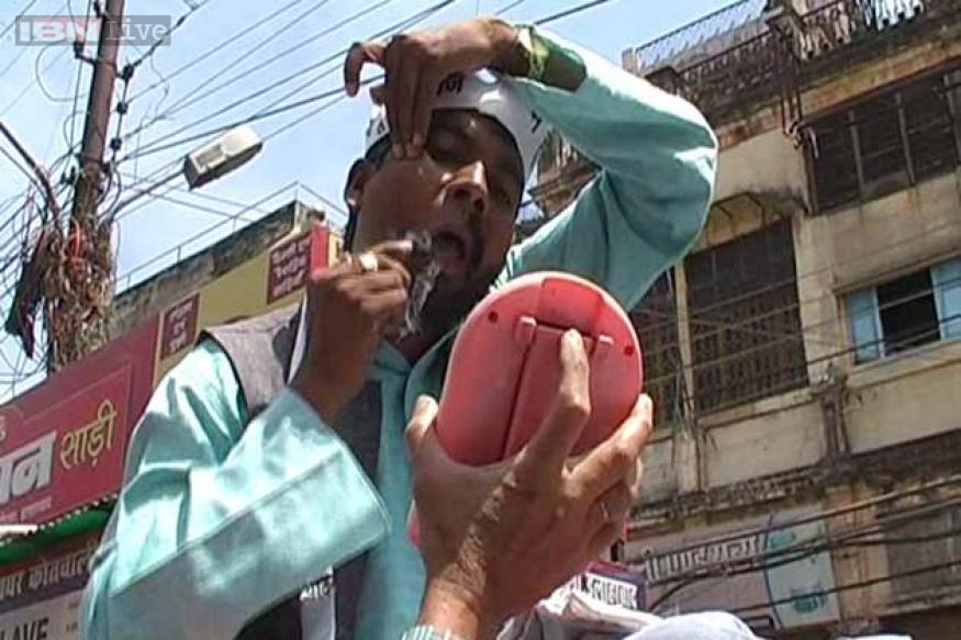 Snapshot: Denied AAP ticket, angry leader shaves off half of his moustache, beard; tours Allahabad on a mule