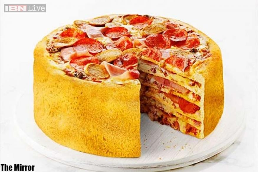 World's first 'Pizza Cake': A 6-tier, fast food monster created by popular Canadian pizza chain after taking a customer poll