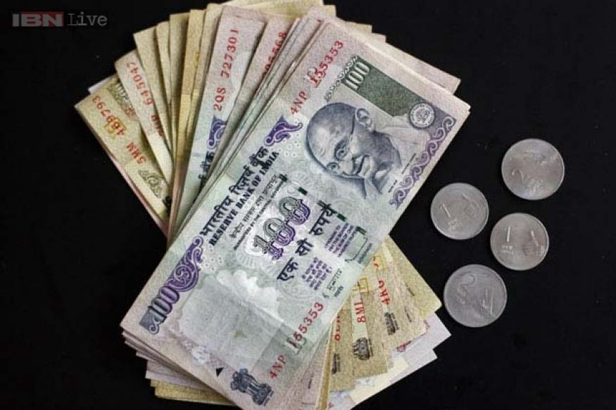 Rupee ends at 60.29 up 8 paise against dollar