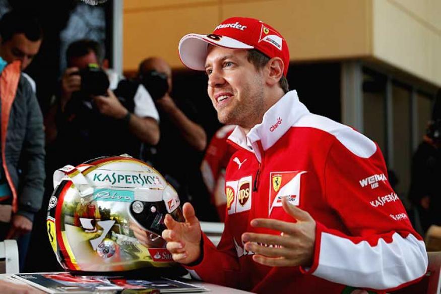 Ferrari's Sebastian Vettel tops wet final practice in Shanghai