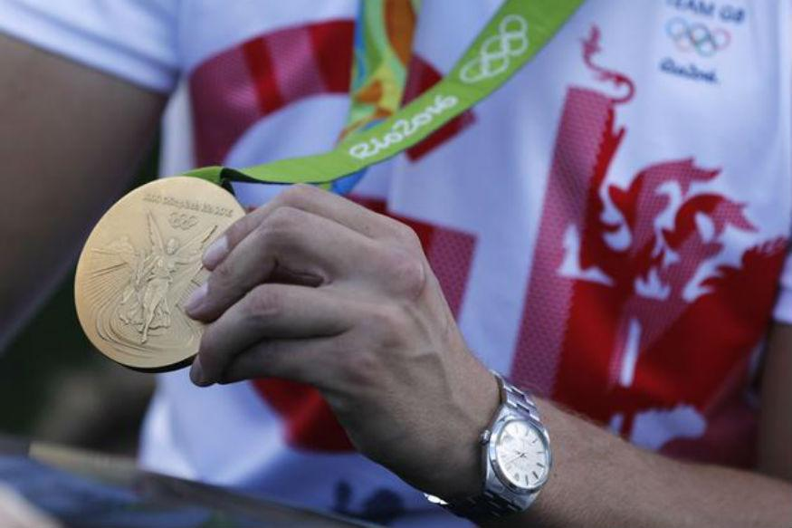 Girl strikes gold by finding stolen Olympic medal in trash