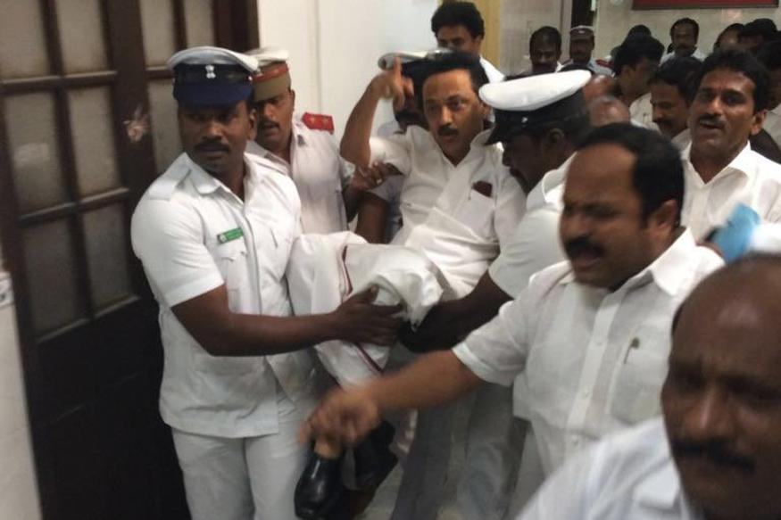 DMK MLAs suspended and evicted, Stalin forced out by marshals