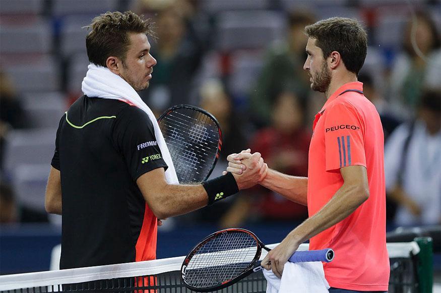 Simon Knocks Out Wawrinka in Shanghai, Djokovic and Murray Advance