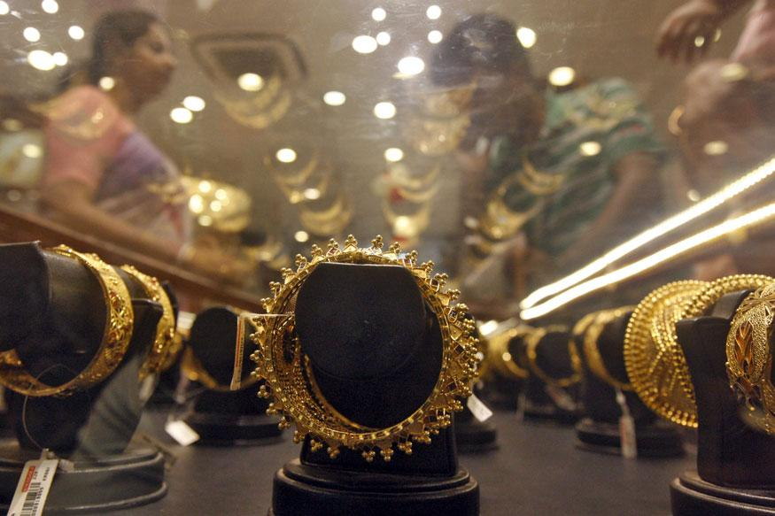 Gold glitters on Dhanteras: Higher prices fail to stop yellow metal shoppers
