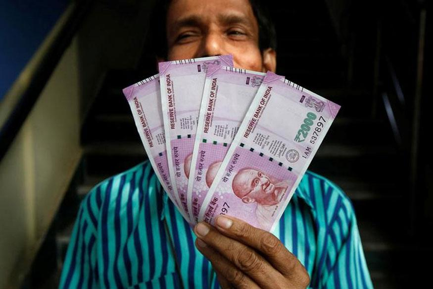 Rupee Weakens 8 Paise Against Dollar in Early Trade