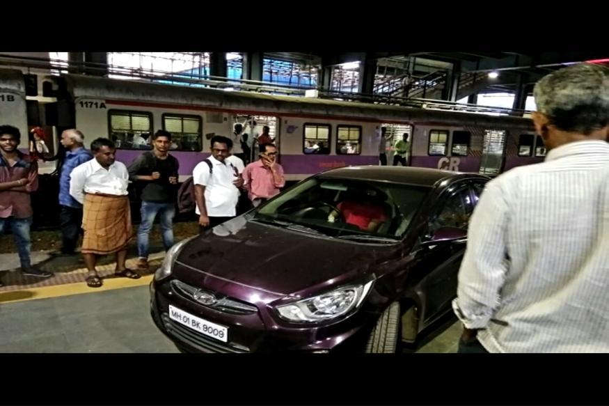 Purple vehicle joins Monday morning commuters on platform 1 of Andheri station